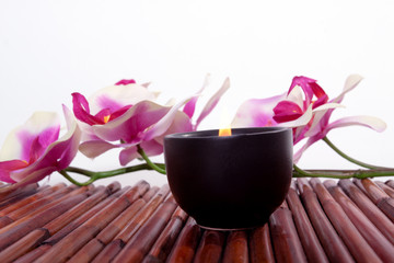 Spa candle and flower for aromatherapy