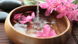 splashing water in flower bowl