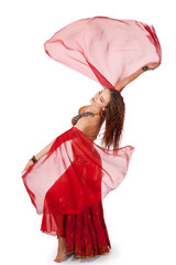 Young belly dancer turning with veil sleeves
