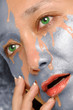 Water washing paint from woman face