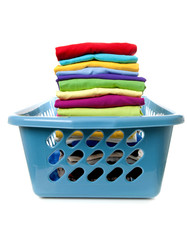 Laundry basket with folded clothes over white backgorund.