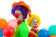 portrait of two children dressed as colorful funny clowns