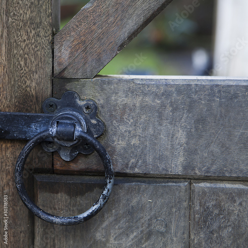 Rusty padlock on fence in Dilverton. Sommerset. England
