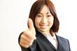 thumb up/サムアップするビジネスウーマン