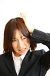grateful business woman/恐縮するビジネスウーマン