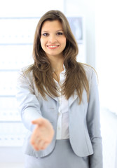 woman with an open hand ready for handshake
