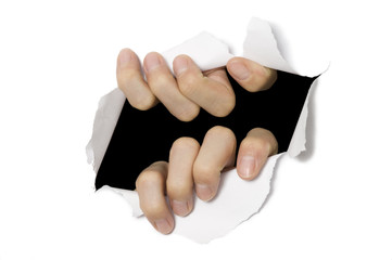 Hands tearing through white paper. Break out!