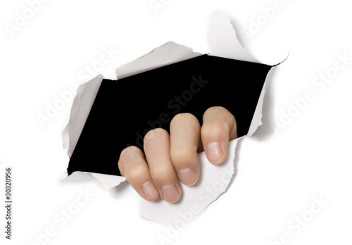 Hand tearing through white paper. Break out!