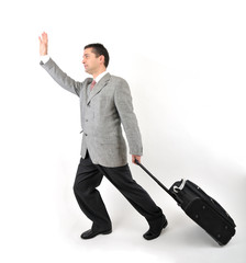 Business traveler with a suitcase isolated on white background.