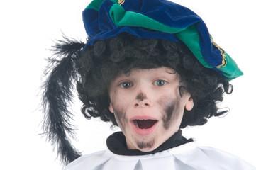 Child playing Zwarte Piet or Black Pete