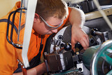 trainee at a metal working lathe 04 poster