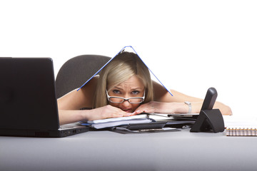 businesswoman sitting at the table stressed and tired at work