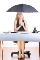 Concept business woman sitting with umbrella in the office