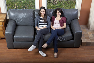 Sisters sitting on couch