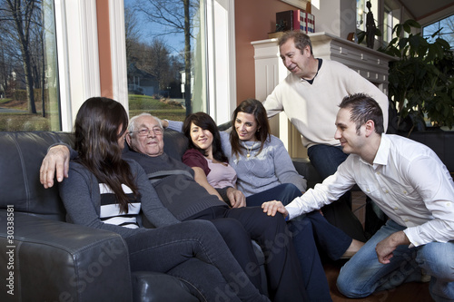 Family visiting elderly relative at a retirement home