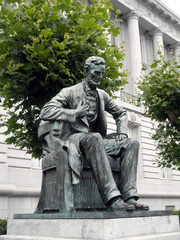 Side angle of Statue of Abe Lincoln sitting down in Front of Cit
