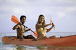 young couple with their kayak in hawaii