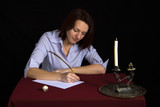 portrait of beautiful brown-haired girl writing work poster