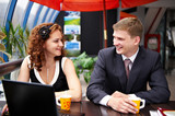 Joyful man and woman on business lunch poster