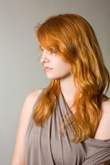 Artistic portrait of gorgeous young redhead.