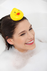 Beautiful young caucasian woman taking a bath