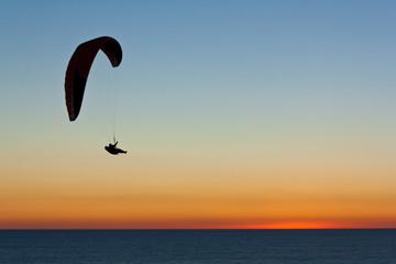 Hang glider at sunset at Torrey Pines