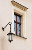 The Wall of Wawel Castle. Wall with window and street lamp. poster