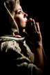 Portrait of praying girl with russian shawl on head. Retouched.