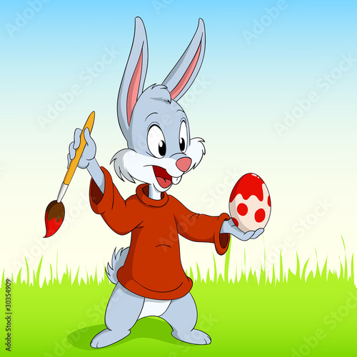 Cartoon easter rabbit paint the egg