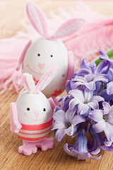 Easter rabbit egg decoration with flower and feather