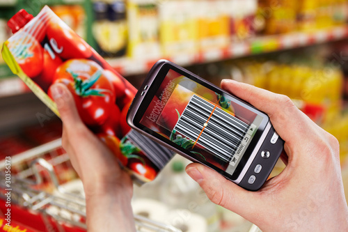 Leinwanddruck Bild barcode scanner on the smartphone