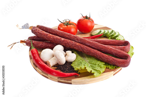 sausages in composition with vegetables