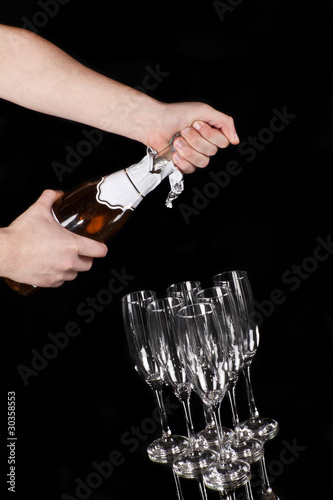 man hands opening champagne bottle