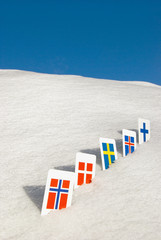 Nordic Europe country flag symbols on snow