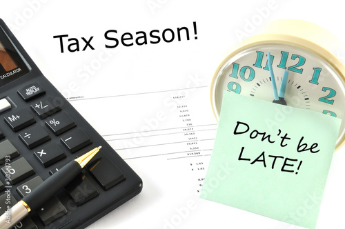 Concept Image with calculator and clock. Tax Season! Don`t be la