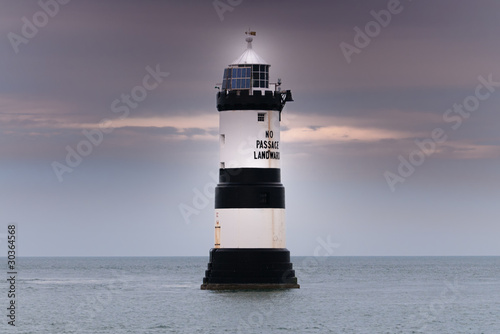 Penmon Lighthouse at sunset on the Isle of Angelsey, Wales.
