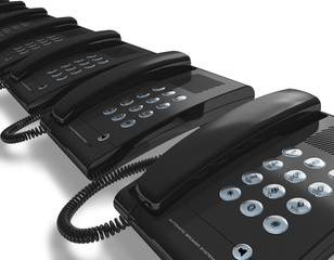 Row of black office phones