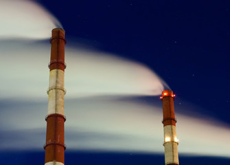 smokestacks  at night, after sunset in winter