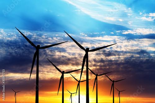 Wind turbine farm over sunset - 30367753