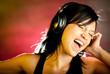 Фото со стока - Pretty young girl listening music.