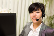 Attractive Young Woman Smiles Wearing Headset