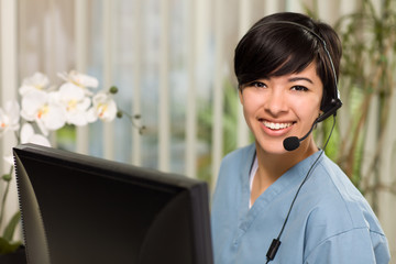 Attractive Multi-ethnic Young Woman Wearing Headset and Scrubs