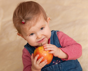 Toddler in casual eating a big red apple