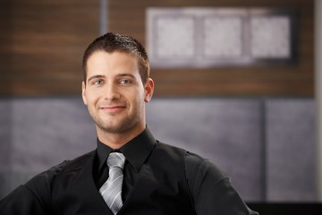 Portrait of goodlooking businessman smiling