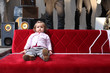 baby on red sofa