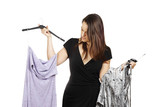 Young brunette deciding what to wear poster