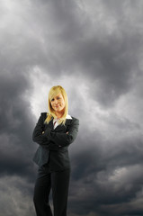 Businesswoman and black cloud