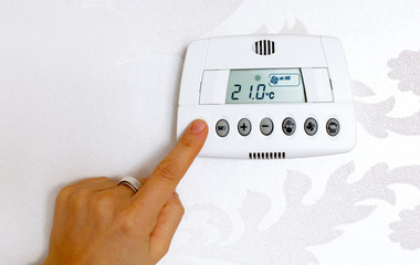 Thermostat temperature digital setting in a modern home