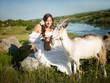young woman herding goats