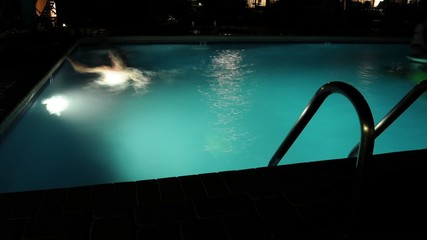 Swimming in a Pool at Night